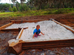 Emily enjoys the sand box at the Ranch