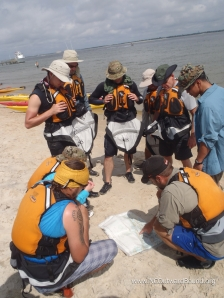 Vets get some instruction on marine navigation on the sea kayaking course.....Courtesy of North Carolina Outward Bound School