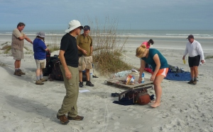 Barry and Lenora prepping Lunch on a palate on Stafford Beach