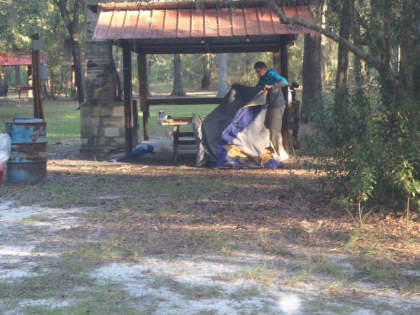 Larry Parsons breaks camp map at the serene Griffis Fish Camp